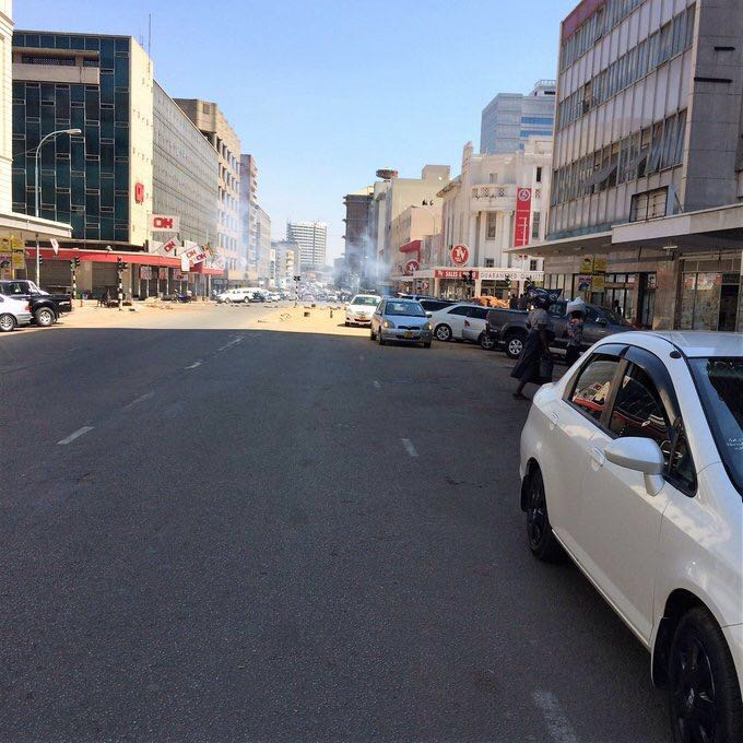More Pictures of Protests in Harare as People Burn Police Cars and Beat Up Police - #MyZimbabweCampaign